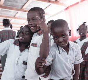 3 boys in school uniform